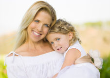 Mother Holding Daughter Flower GIrl Stock Photos