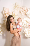 Mother holding daughter in his arms royalty free stock images