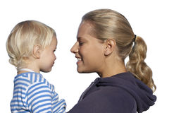 Mother holding daughter, smiling, close-up, profile, cut out Stock Images