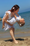 Mother holding daughter upside down Royalty Free Stock Photo