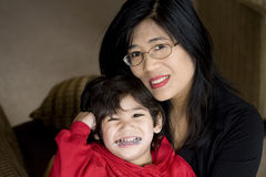 Mother holding disabled son. With mouth guard Stock Photography