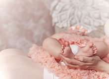 Mother holding feet of her first child. Royalty Free Stock Photography