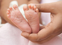 Mother Holding Feet of Newborn Baby Royalty Free Stock Photography
