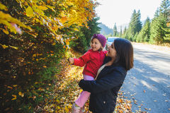 Mother Holding Girl in Hands Royalty Free Stock Images