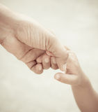 Mother holding a hand of child Stock Photo