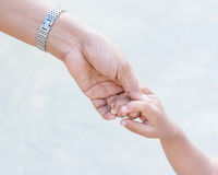 Mother holding a hand of child Stock Photography