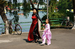 Mother holding hand children walking in park Royalty Free Stock Photography
