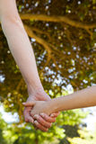 Mother holding a hand of her daughter outdoors Royalty Free Stock Photo