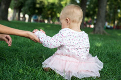Mother holding a hand of her daughter Royalty Free Stock Images