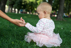 Mother holding a hand of her daughter Royalty Free Stock Photo