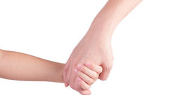 Mother holding a hand of her son. Isolated on white background stock image