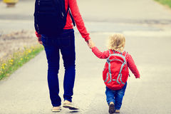 Mother holding hand of little daughter with Royalty Free Stock Photo