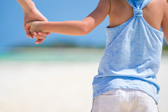 Mother holding hand of little kid outdoors Royalty Free Stock Images