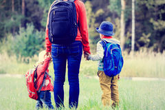 Mother holding hands of kids going to school or Royalty Free Stock Photos
