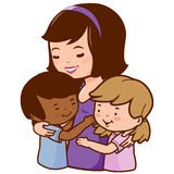 Mother holding her adopted children. Royalty Free Stock Photography