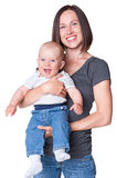 Mother holding her adorable baby Stock Images