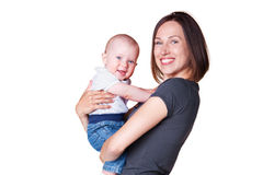 Mother holding in her arms smiley son Stock Photography