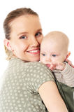 Mother holding her baby. Young mother holding her baby Stock Photography
