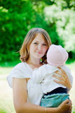 Mother Holding Her Baby Royalty Free Stock Images
