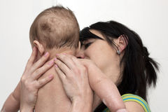 Mother holding her baby boy Stock Photo