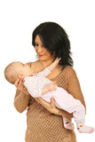 Mother holding her baby girl Stock Image