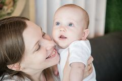 Mother holding her baby son. Close up family portrait Royalty Free Stock Photo