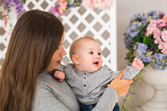 Mother holding her child. Mom playing with laughing kid. Family at home Stock Image