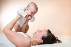 Mother holding her cute baby Royalty Free Stock Image