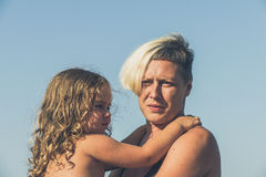 Mother holding her daughter Stock Photos