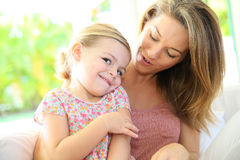Mother holding her daughter in the arms Royalty Free Stock Image