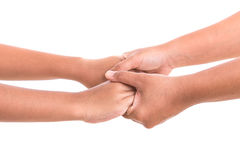 Mother holding her daughter hand. Help or support concept. Isola Royalty Free Stock Image