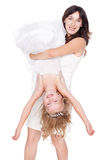 Mother holding her daughter upside down Stock Images