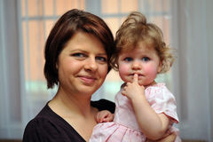 Mother holding her dauther in one's arms Stock Images