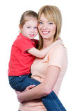 Mother holding her little daughter royalty free stock image
