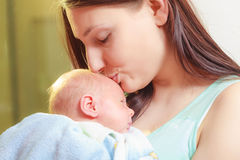 Mother holding her little newborn baby Royalty Free Stock Photos