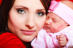 Mother holding her little newborn baby Stock Photography