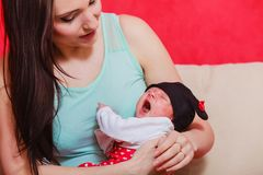 Mother holding her little newborn baby Stock Images
