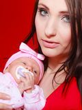 Mother holding her little newborn baby Stock Photos