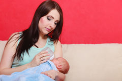 Mother holding her little newborn baby Royalty Free Stock Photo