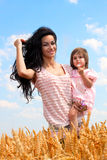Mother holding her lovely daughter Royalty Free Stock Photos