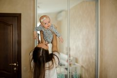 Mother holding her little daughter up in the air Stock Images