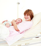 Mother holding her newborn baby. In hospital Royalty Free Stock Image