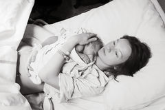 Mother holding her newborn baby after labor in a hospital. stock photography