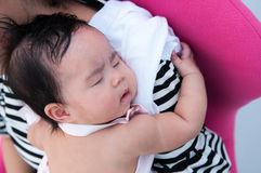 Mother holding her newborn baby in sexy dress while her was sleeping. Mother day bonding concept with newborn baby nursing. Mother holding her newborn baby in Stock Images