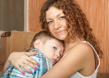 Mother holding her son. Stock Images