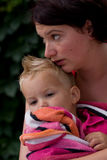 Mother is holding her son. In a towel Royalty Free Stock Image