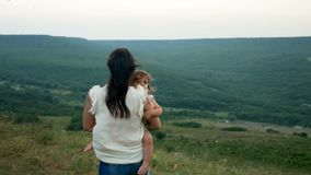 Mother holding her son stock footage