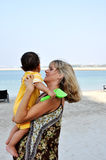 Mother holding her son on hands at beach Royalty Free Stock Image