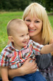 Mother is holding her son in her arms Royalty Free Stock Images