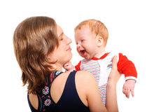 Mother holding her son and playing Royalty Free Stock Photography